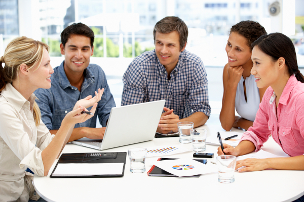 individuals in business meeting discussing price quote