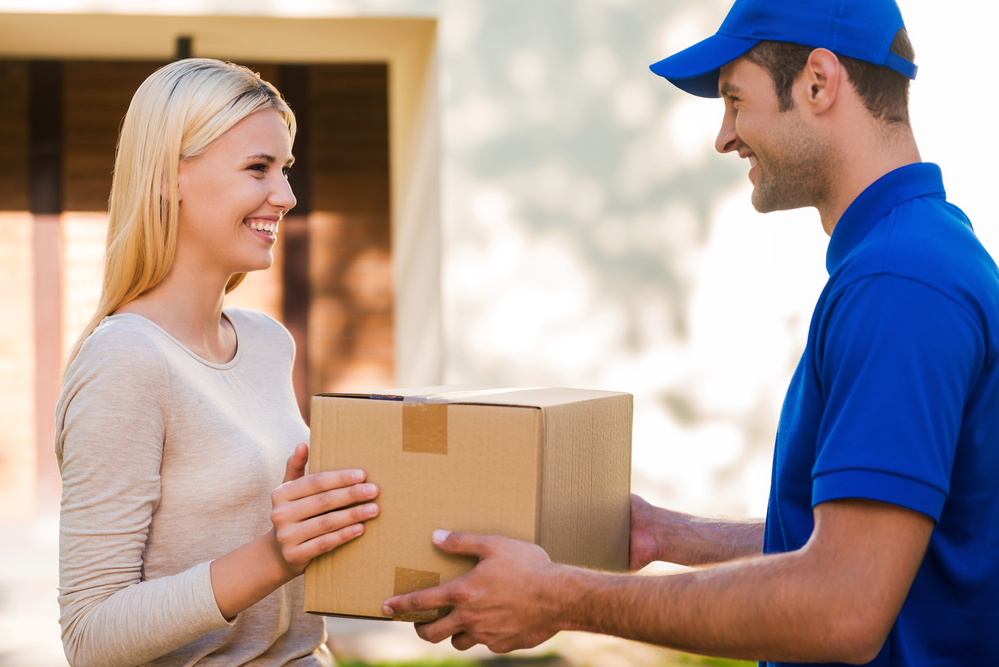 Delivery worker handing off package to a customer