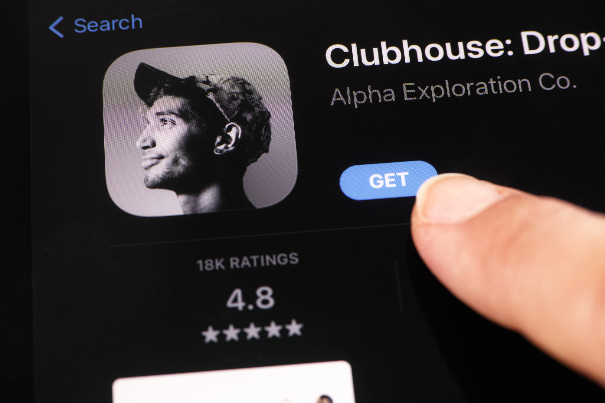 Close up shot of the Clubhouse app on the screen of an Ipad