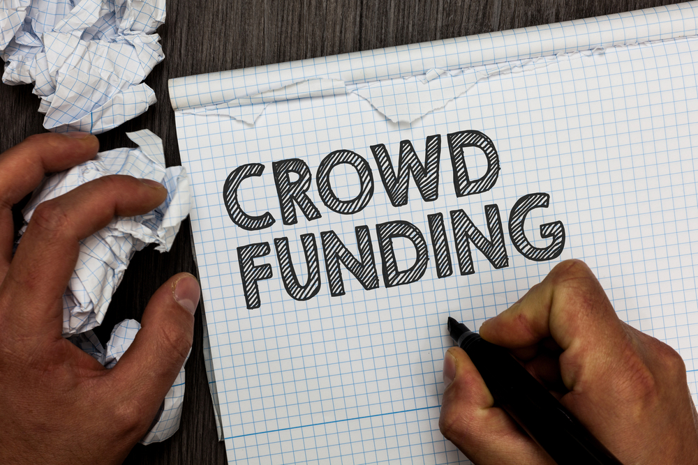 Word writing text Crowd Funding. Business concept for Fundraising Kickstarter Startup Pledge Platform Donations Man holding marker notebook crumpled papers several tries mistakes made