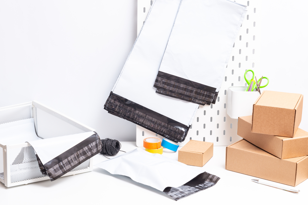 packaging materials including cardboard boxes, poly bags, and packaging tape